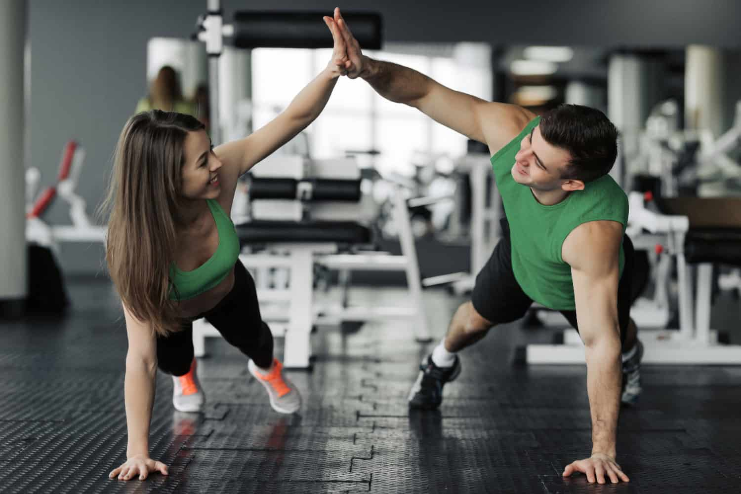 gym goers high-fiving - digital marketing for gyms
