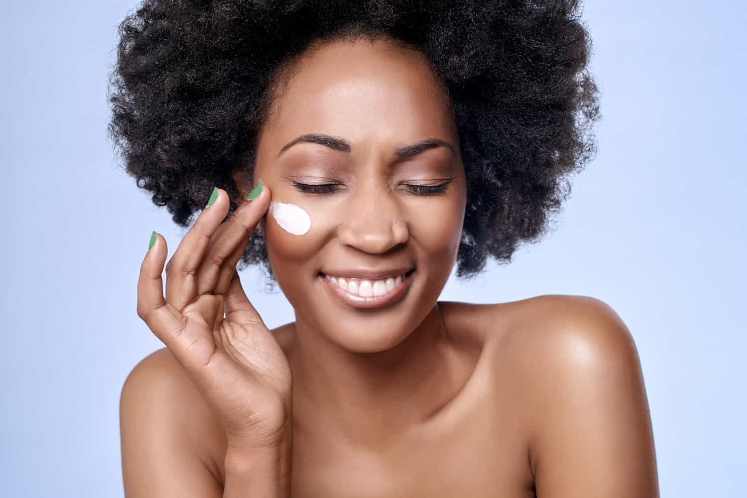 lady applying face cream - digital marketing for skincare products