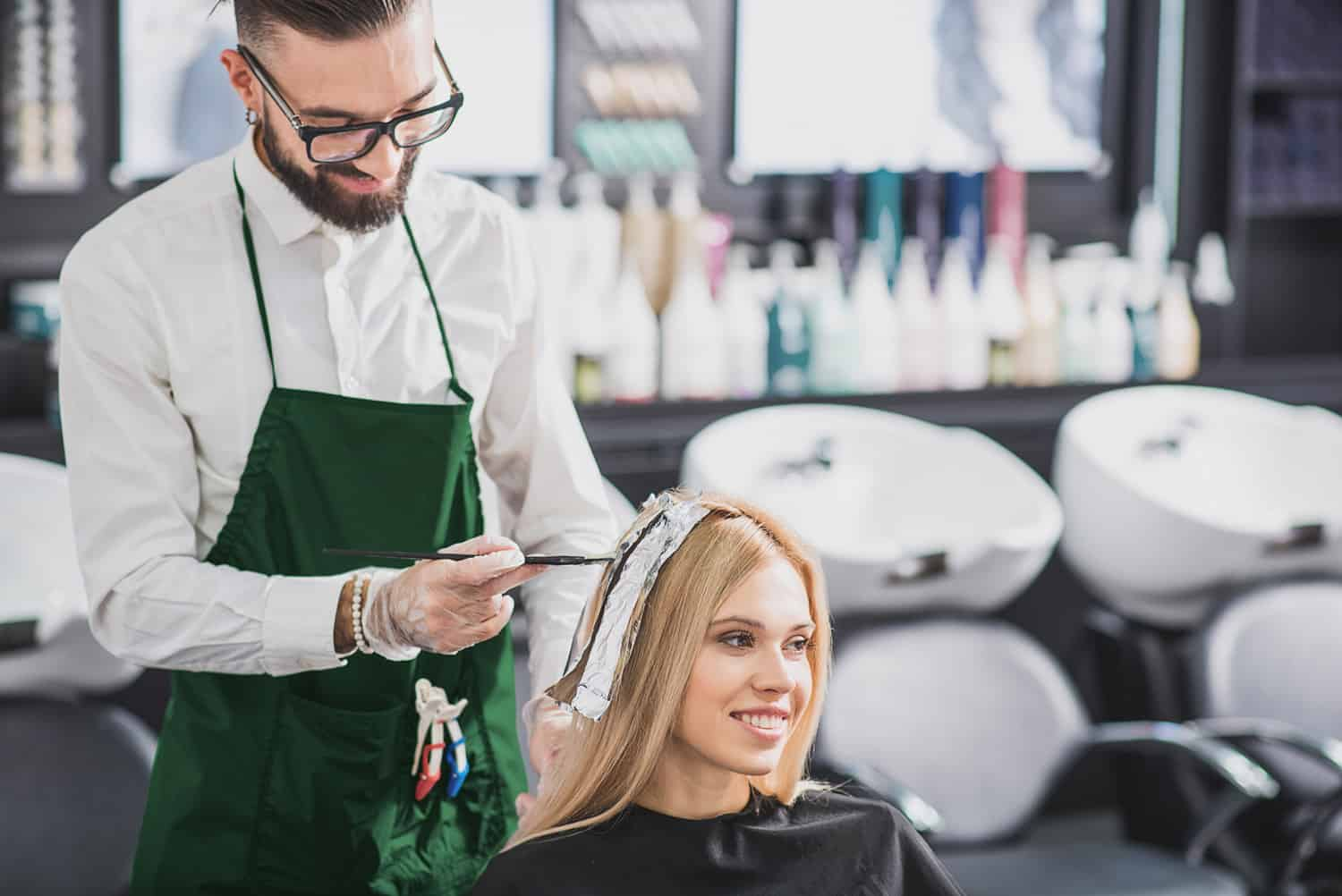 Hairdressers colouring hair - Hair Salon Digital Marketing