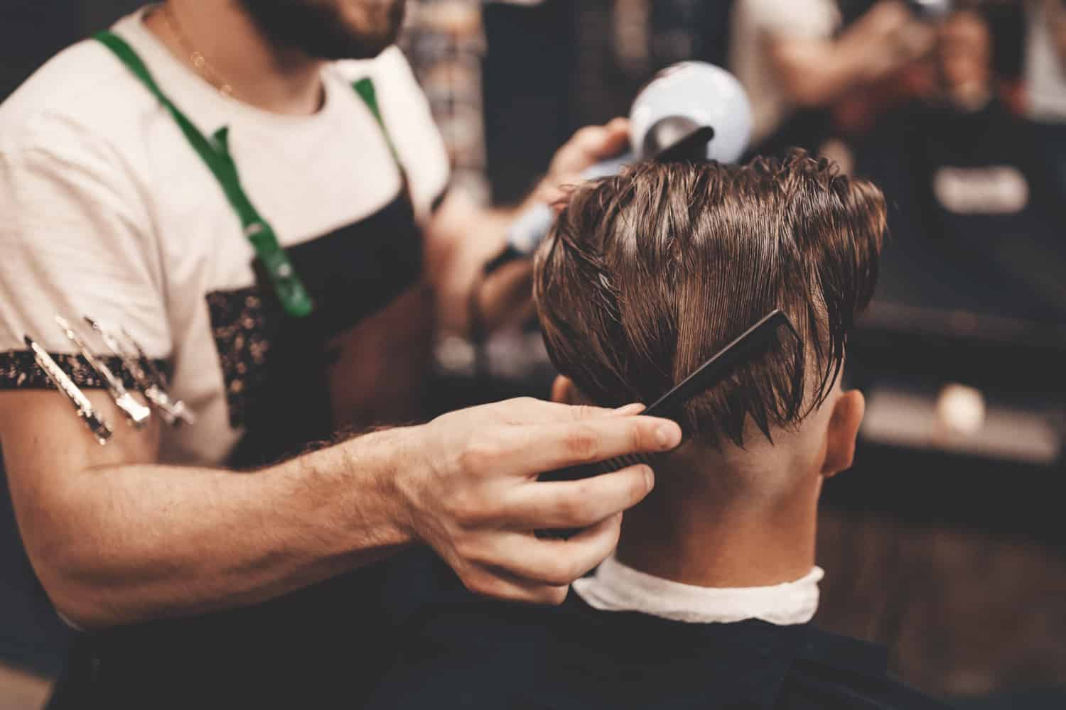 barber cutting hair - digital marketing for barbers